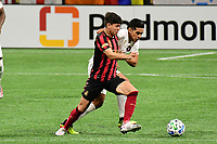 ATLANTA, GA - SEPTEMBER 02: Matheus Rossetto #9 of Atlanta United FC fights for control of the ball with Ben Sweat #22 of Inter Miami CF during a game between Inter Miami CF and Atlanta United FC at Mercedes-Benz Stadium on September 02, 2020 in Atlanta, Georgia.