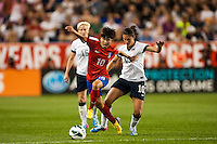 Korea Republic (KOR) forward Ji Soyun (10) and United States (USA) midfielder Carli Lloyd (10). The women's national team of the United States defeated the Korea Republic 5-0 during an international friendly at Red Bull Arena in Harrison, NJ, on June 20, 2013.