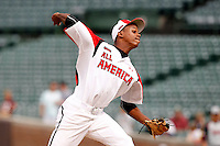 Pitcher Yency Almonte #9 of Columbus High School in Miami, Florida delivers a pitch during the Under Armour All-American Game at Wrigley Field on August 13, 2011 in Chicago, Illinois.  (Mike Janes/Four Seam Images)