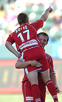 Chicago Fire's Chris Rolfe gets picks up teammate Chad Barett after scoring a goal in the first half against the Los Angeles Galaxy in Carson, CA on Sunday, September 4, 2005.Photo by Matt A. Brown/ISI