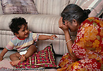 12 month old baby boy with grandmother, interaction playing peek-a-boo horizontal Grandmother takes care of him while parents work