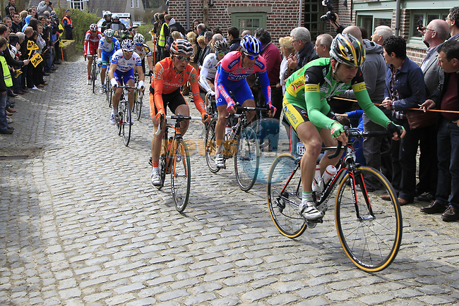 The breakaway group including Baptiste Planckaert (BEL) Landbouwkrediet-Euphony, Peio Bilbao (ESP) Euskaltel-Euskadi and Massimo Graziato (ITA) Lampre-ISD climb Molenberg during the 96th edition of The Tour of Flanders 2012, running 256.9km from Bruges to Oudenaarde, Belgium. 1st April 2012. <br /> (Photo by Eoin Clarke/NEWSFILE).