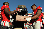 December 30, 2016: Georgia Bulldogs Sony Michel (1) and Trenton Thompson (78) attempt to lift the AutoZone Liberty Bowl trophy after winning the game over TCU at Liberty Bowl Memorial Stadium in Memphis, Tennessee. ©Justin Manning/Eclipse Sportswire/Cal Sport Media