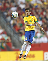 Brazil forward Neymar (10) heads the ball.  In an international friendly, Brazil (yellow/blue) defeated Portugal (red), 3-1, at Gillette Stadium on September 10, 2013.