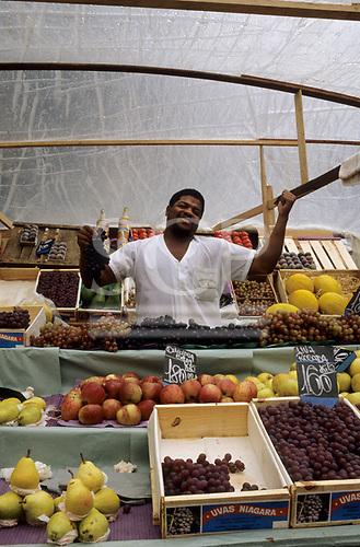 Rio de Janeiro,  Brazil. Fruit seller at his stall in the market.