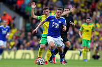 28th August 2021; Carrow Road, Norwich, Norfolk, England; Premier League football, Norwich versus Leicester; Jamie Vardy of Leicester City is under pressure from Billy Gilmour of Norwich City