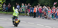 Police motorcyclists preceeded the racers and had fun with the crowds.  Olympics 2012.  Women's cycle road race passes along the Shere bypass, the A25, on it's way to Box Hill and then back to the finish in London.