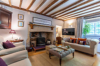 BNPS.co.uk (01202 558833)<br /> Pic: Strutt&Parker/BNPS<br /> <br /> Pitcured: Living room. <br /> <br /> An 18th century cottage in 'the prettiest village in England' is on the market for £675,000.<br /> <br /> Number 2 School Lane is Grade II listed, built with beautiful Cotswold stone and filled with character features like exposed timber beams and original fireplaces.<br /> <br /> The attractive three-bedroom property is in the highly sought after Wiltshire village of Castle Combe.<br /> <br /> The quintessentially English village has been used regularly as a film location and the houses are mostly made with honey-coloured Cotswold stone.
