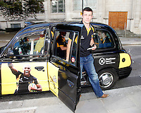 Photo: Richard Lane/Richard Lane Photography. London Wasps reception at the Central London offices of the Club's Official Main Sponsor, CVS, the business rates specialist. 02/09/2013. Wasps' captain, Chris Bell arrives in a Wasps branded London taxi.
