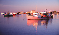 Colorful fishing boats at the harbor, Seabrook, New Hampshire. Photograph by Peter E. Randall