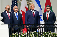 "United States President Donald J. Trump and First lady Melania Trump host a signing ceremony of the ""Abraham Accords"" on the South Lawn of the White House in Washington, DC on Tuesday, September 15, 2020.  The Trumps are joined by Prime Minister Benjamin Netanyahu of Israel; Sheikh Abdullah bin Zayed bin Sultan Al Nahyan, Minister of Foreign Affairs and International Cooperation of the United Arab Emirates; and Dr. Abdullatif bin Rashid Alzayani, Minister of Foreign Affairs, Kingdom of Bahrain.<br /> Credit: Chris Kleponis / Pool via CNP /MediaPunch"