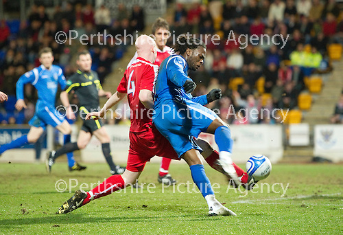 St Johnstone v Brechin....22.03.11  Scottish Cup Quarter Final replay.Collin Samuel fires the ball in to make it 1-0.Picture by Graeme Hart..Copyright Perthshire Picture Agency.Tel: 01738 623350  Mobile: 07990 594431