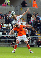 ATTENTION SPORTS PICTURE DESK<br /> Pictured: Alan Tate of Swansea (TOP) wins a header on top of Marcel Seip of Blackpool.<br /> Re: Coca Cola Championship, Swansea City Football Club v Blackpool at the Liberty Stadium, Swansea, south Wales. Saturday 24 October 2009
