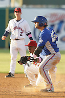 May 9, 2010: Albert Cartwright of the Lancaster JetHawks tags out Travis Denker of the Inland Empire 66'ers at Clear Channel Stadium in Lancaster,CA.  Photo by Larry Goren/Four Seam Images