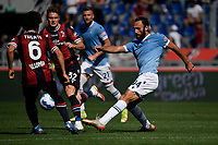 Arthur Theate of Bologna FC and Vedat Muriqi of SS Lazio compete for the ball during the Serie A football match between Bologna FC and SS Lazio at Renato Dall'Ara stadium in Bologna (Italy), October 3rd, 2021. Photo Andrea Staccioli / Insidefoto