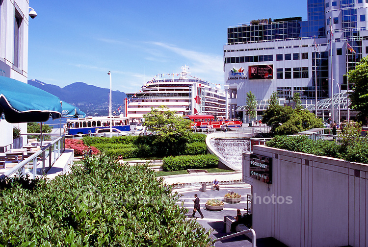 "Overlooking ""Waterfront Centre"" and Cruise Ship docked at ""Canada Place"" Trade and Convention Centre and Cruise Ship Terminal, Vancouver, British Columbia, Canada"