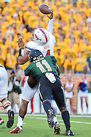 SMU quarterback Matt Davis (4) is rushed by Baylor linebacker Taylor Young (11) during first half of NCAA inaugural Football game at newly constructed McLean Stadium, Sunday, August 31, 2014 in Waco, Tex. Baylor leads SMU 31-0 in the first half. (Mo Khursheed/TFV Media via AP Images)
