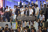 Pro-democracy protesters are seen on Nathan Road, shortly before the Hong Kong police lost control of the area, and thus ceding it back to the protesters, who had only just lost it to the police hours earlier in a pre-dawn raid, Mong Kok, Kowloon, Hong Kong, China, 18 October 2014.