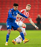9th January 2021; Bet365 Stadium, Stoke, Staffordshire, England; English FA Cup Football, Carabao Cup, Stoke City versus Leicester City; James Justin of Leicester City is tackled by Nathan Collins of Stoke City