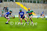 St Brendan's Kevin Orpen hand passes to his team mate Eoghan Kearney as Crotta's Declan O'Donoghue keeps an eye on them, in the County Senior Hurling Championship quarter final
