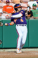 Center Fielder Thomas Brittle #4 swings at a pitch during a  game against the Miami Hurricanes at Doug Kingsmore Stadium on March 31, 2012 in Clemson, South Carolina. The Tigers won the game 3-1. (Tony Farlow/Four Seam Images).