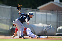 Asheville Tourists third baseman Shane Hoelscher (29) tags out Louie Lechich (21) of the Kannapolis Intimidators as he tries to steal third base at Intimidators Stadium on June 28, 2015 in Kannapolis, North Carolina.  The Tourists defeated the Intimidators 6-4.  (Brian Westerholt/Four Seam Images)
