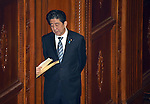 December 24, 2014, Tokyo, Japan - Prime Minister Shinzo Abe talks to unseen aide through the door before a parliamentary process to elect Japan's new leader during a special Diet session convened in Tokyo on Wednesday, December 24, 2014. Abe was re-elected as prime minister and set to form a new Cabinet. (Photo by Natsuki Sakai/AFLO)