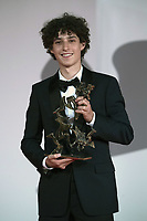 """Filippo Scotti poses with the Marcello Mastroianni Award for Best New Young Actor for """"The Hand Of God"""" during the Winners Red Carpet as part of the 78th Venice International Film Festival in Venice, Italy on September 11, 2021. <br /> CAP/MPI/IS/PAC<br /> ©PAP/IS/MPI/Capital Pictures"""
