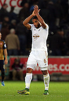 Team captain Ashley Williams of Swansea greets home supporters after the Barclays Premier League match between Swansea City and Arsenal at the Liberty Stadium, Swansea on October 31st 2015