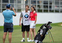 Sam Quek MBE (GBR Hockey) and caddy boyfriend Tom Mairs pose for a photo during the BMW PGA PRO-AM GOLF at Wentworth Drive, Virginia Water, England on 23 May 2018. Photo by Andy Rowland.