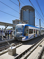 Ethiopia. Addis Ababa. Passengers wait on tramway station. Addis Ababa Light Rail is a light rail transportation system in Addis Ababa. A 17-kilometre line running from the city centre to industrial areas in the south of the city opened on 20 September 2015. Service began on 9 November 2015 for the second line (west-east). The total length of both lines is 32 kilometres with 32 stations. Trains are expected to be able to reach maximum speeds of 70 km/h. The railway was contracted by the China Railway Group Limited and is nowdays operated by the Shenzhen Metro Group. The Ethiopian Railways Corporation began construction of the double track electrified light rail transit project in December 2011 after securing funds from the Export-Import Bank of China. This light-rail system was the first to be built in sub-saharan Africa. Addis Ababa is the capital city and the name of a region of Ethiopia. 20.11.15 © 2015 Didier Ruef