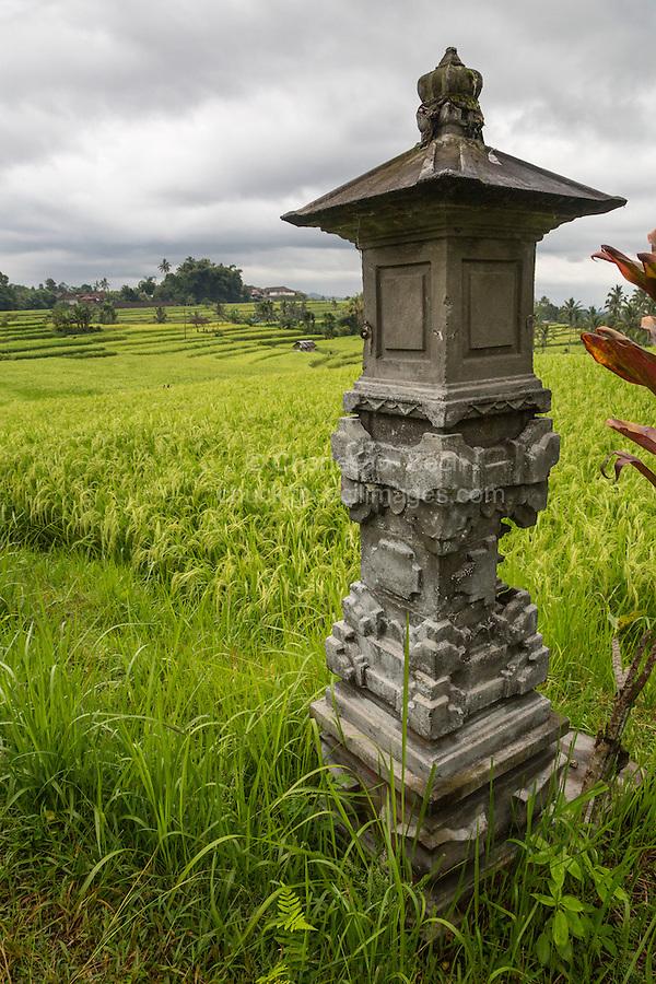 Jatiluwih, Bali, Indonesia.  Shrine to the Rice Goddess Sri.  Terraced Rice Paddies in the Distance.