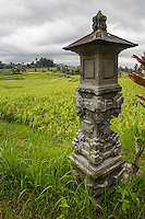 Jatiluwih, Bali, Indonesia.  Shrine to the Rice Goddess Sri.  Terraced Rice Paddies in the Distance.