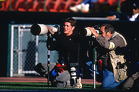 SAN FRANCISCO, CA - Photographers Jed Jacobsohn and Terry Schmitt shoot a game between the Kansas City Chiefs and San Francisco 49ers on November 11, 2001 at Candlestick Park in San Francisco, California. (Photo by Brad Mangin)