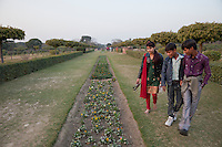 Agra, India.  Indians Walking in the Mehtab Bagh Gardens, across the Yamuna River from the Taj Mahal.