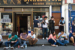 Brick Lane, Tower Hamlets Chinese restaurant sitting on pavement eating outside London E1 UK