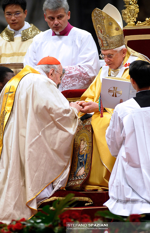 Pope Benedict XVI (L) gives his cardinal ring to Spanishe Mnuel Estepa Llaurens R) during the Eucharistic celebration with the new cardinals on November 21, 2010 at St Peter's basilica at The Vatican. 24 Roman Catholic prelates joined the day before the Vatican's College of Cardinals, the elite body that advises the pontiff and elects his successor upon his death.
