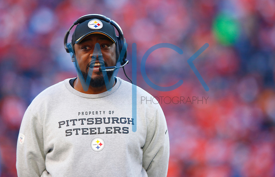 Head coach Mike Tomlin of the Pittsburgh Steelers looks on against the Denver Broncos during the AFC Divisional Round Playoff game at Sports Authority Field at Mile High on January 17, 2016 in Denver, Colorado. (Photo by Jared Wickerham/DKPittsburghSports)