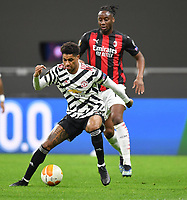 18th March 2021; San Siro stadium, Milan, Italy;  AC Milans Soualiho Meite is held off by Manchester Uniteds Marcus Rashford during the Europa League round of 16 second leg match between AC Milan and Manchester United in Milan, Italy