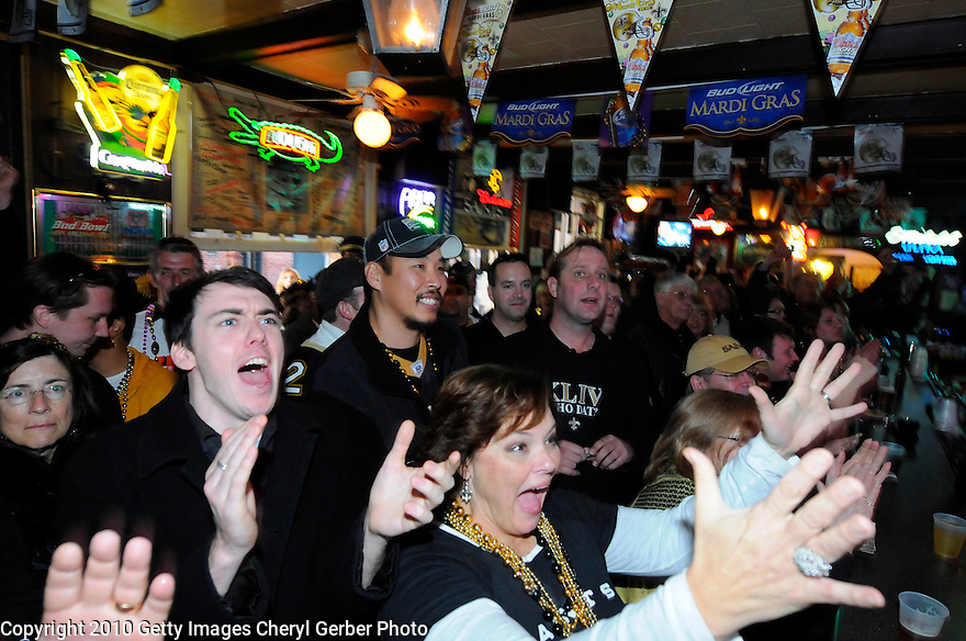NEW ORLEANS - FEBRUARY 07:  New Orleans Saints fans Barrett Macgowan, Will Lo and Lynne Wilkinson watch the Saints play against the Indianapolis Colts during Super Bowl XLIV at a French Quarter bar on February 7, 2010 in New Orleans, Louisiana.  (Photo by Cheryl Gerber/Getty Images)