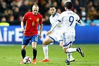 Spain's Andres Iniesta (l) and Israel's Rami Gershon (c) and Lior Refaelov during FIFA World Cup 2018 Qualifying Round match. March 24,2017.(ALTERPHOTOS/Acero) /NortePhoto.com
