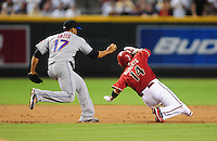 Aug. 11, 2009; Phoenix, AZ, USA; Arizona Diamondbacks base runner Ryan Roberts (14) is tagged out by New York Mets third baseman Fernando Tatis (17) during a seventh inning run down at Chase Field. Mandatory Credit: Mark J. Rebilas-