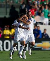 Pasadena, CA - June 25, 2011: Clint Dempsey congratulates Landon Donovan after scoring a goal  vs Mexico in the 2011 CONCACAF Gold Cup Championships, at the Rose Bowl. Mexico won 4-2.