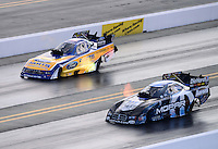 Sept. 15, 2012; Concord, NC, USA: NHRA funny car driver Matt Hagan (right) races alongside Bob Tasca III during qualifying for the O'Reilly Auto Parts Nationals at zMax Dragway. Mandatory Credit: Mark J. Rebilas-