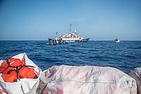 Sea Watch-2.<br /> Die Sea Watch-2 bei ihrer 13. SAR-Mission vor der libyschen Kueste.<br /> Im Bild: Ein Schlauchboot mit ca. 160 Menschen wird von der Sea Watch-Crew betreut. Im Vordergrund liegen Schwimmwesten zur Verteilung bereit.<br /> 20.10.2016, Mediterranean Sea<br /> Copyright: Christian-Ditsch.de<br /> [Inhaltsveraendernde Manipulation des Fotos nur nach ausdruecklicher Genehmigung des Fotografen. Vereinbarungen ueber Abtretung von Persoenlichkeitsrechten/Model Release der abgebildeten Person/Personen liegen nicht vor. NO MODEL RELEASE! Nur fuer Redaktionelle Zwecke. Don't publish without copyright Christian-Ditsch.de, Veroeffentlichung nur mit Fotografennennung, sowie gegen Honorar, MwSt. und Beleg. Konto: I N G - D i B a, IBAN DE58500105175400192269, BIC INGDDEFFXXX, Kontakt: post@christian-ditsch.de<br /> Bei der Bearbeitung der Dateiinformationen darf die Urheberkennzeichnung in den EXIF- und  IPTC-Daten nicht entfernt werden, diese sind in digitalen Medien nach §95c UrhG rechtlich geschuetzt. Der Urhebervermerk wird gemaess §13 UrhG verlangt.]