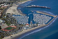 aerial photograph of the Santa Barbara Harbor, California, Stearns Wharf in the background, the Santa Barbara Community College football field on the left