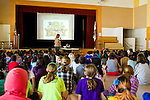 North American Cougar (Puma concolor couguar) conservationist, Jennifer Addison, educating elementary school children about pumas, Berkeley, Bay Area, California