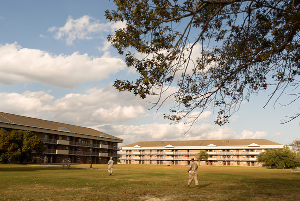 October 21, 2014. Camp LeJeune, North Carolina.<br />  Marines from the Ground Combat Element Integrated Task Force walk across the lawn in front of the coed barracks where the unit is housed during training.<br />  The Ground Combat Element Integrated Task Force is a battalion level unit created in an effort to assess Marines in a series of physical and medical tests to establish baseline standards as the Corps analyze the best way to possibly integrate female Marines into combat arms occupational specialities, such as infantry personnel, for which they were previously not eligible. The unit will be comprised of approx. 650 Marines in total, with about 400 of those being volunteers, both male and female. <br />  Jeremy M. Lange for the Wall Street Journal<br /> COED