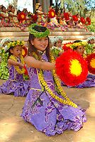 A lei day performance by Halau Hula O Hokulani at the Waikiki bandstand in Kapiolani park.