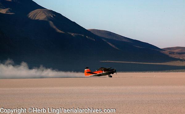 An Antonov AN-2, N87AN, biplane rolls out after a landing at the Black Rock Desert, Nevada
